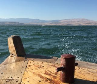 A picture of a wooden dock on the blue waters of the Sea of Galilee.