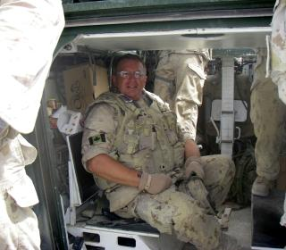 The Rev. Jim Short, in military fatigues, prepares for pastoral visitation in a war zone, as he heads out with a convoy to visit the troops at various forward operating bases and strong points in Afghanistan.