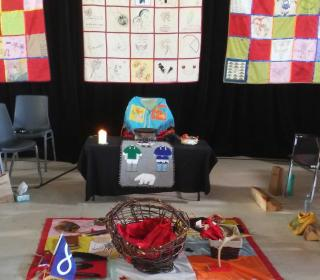 An altar at the Missing and Murdered Indigenous Women and Girls hearing in Maliotenam, Quebec.