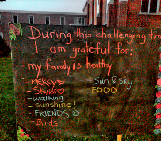 Outdoor blackboard inviting people to write what they're grateful for