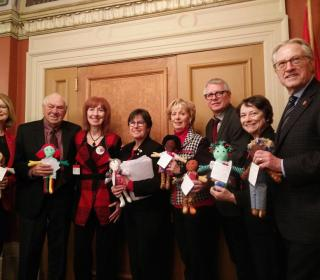 Senators and MPs with their Dolls of Hope