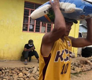 The Serve the People Brigade of the Cordillera Disaster Response Network distributes rice to people in need