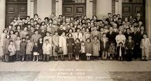 A large photo of the congregation of Southern Japanese United Church, Easter 1953, gathered on the steps of the church. Everyone is dressed in suits and dresses for the occasion.