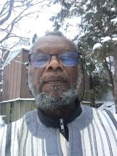 A selfie of Rev. Dr. Samuel Vauvert Dansokho, a Black man with a graying beard and glasses. Photographed outside in a snowy background.