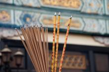 Numerous sticks of incense burn in front at a temple in Hong Kong.