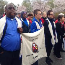 The author Paul Douglas Walfall (left) marches with the members of the United Church of Canada Delegation to the ACT March to End Racism carry a United Church banner at the event.