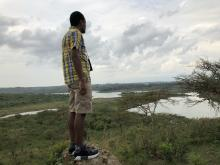 The author Adam Kilner looking out over the Tanzanian landscape.