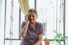 Elderly woman on the phone, laughing
