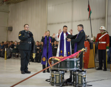 Military chaplains from several different denominations consecrate the guidon of the Saskatchewan Dragoons in a ceremony.
