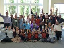 The Australian and Canadian members of the Dialogue on Reconciliation gather and wave to the camera.