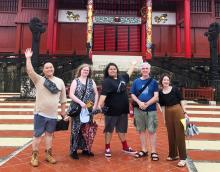 Participants in the Minority Youth Forum, including two youth featured in this blog post (centre), pose for a group shot in front of a Japanese temple.