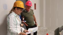 Consolidation project team members review construction plans with an advisor.