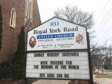 "A church sign outside Royal York United Church says ""Church Suspended, with Prayers for Mending of the World."""