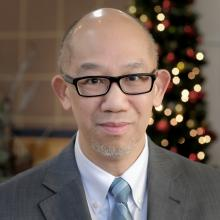 A photograph portrait of Rev. Dr. Alan Lai.