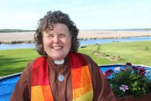 Sharon Ballantyne wearing a colourful minister's stole across her shoulders. Sharon Ballantyne is ministry personnel, serving a rural pastoral charge about two hours northeast of Toronto. A 2018 McGeachy Senior scholar, her work is focusing on equity.