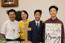 The author, SunDo Hyun, and family