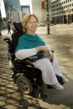 Tracy Odell in her power wheelchair on a Toronto street.