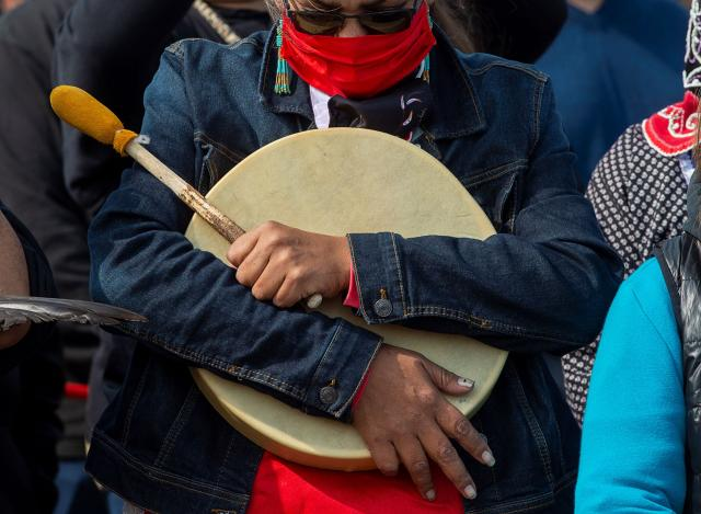 Mi'kmaq drummer pauses during prayer