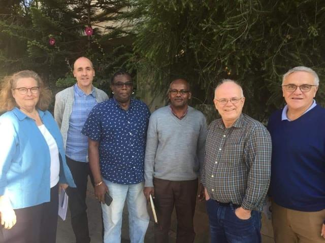 Six members of the CFGB Board of Directors in a line smiling at the camera in Ethiopia