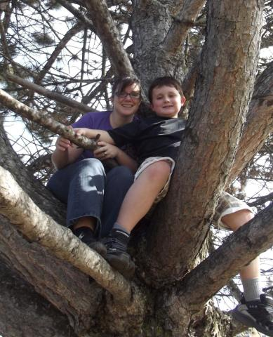 Trisha Elliott and her son Aidan are up in a tree.