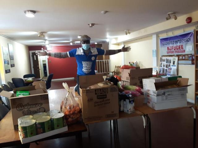 At Beaconsfield United Church, Adedeji prepares to deliver food to newcomers.