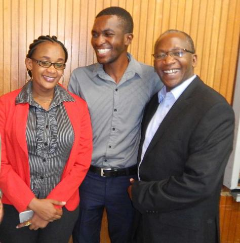 Three members of Pembizo Christian Council, Africa smiling.