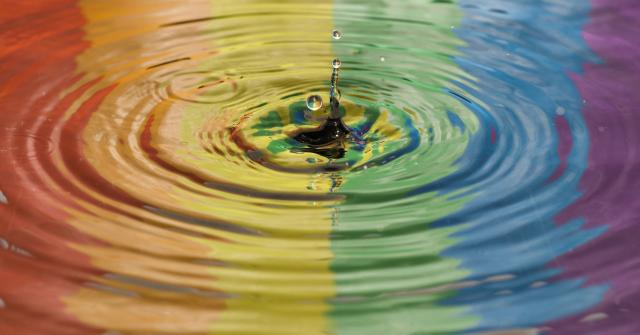 Rainbow reflected in water