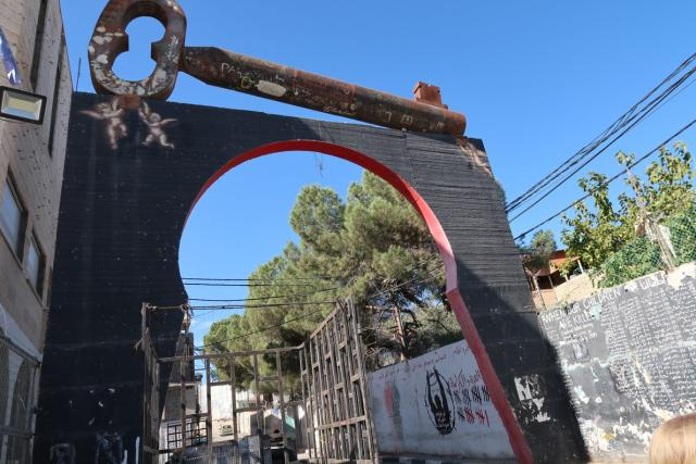 Photo of gate with large metal key sculpture, Aida refugee camp, Bethlehem