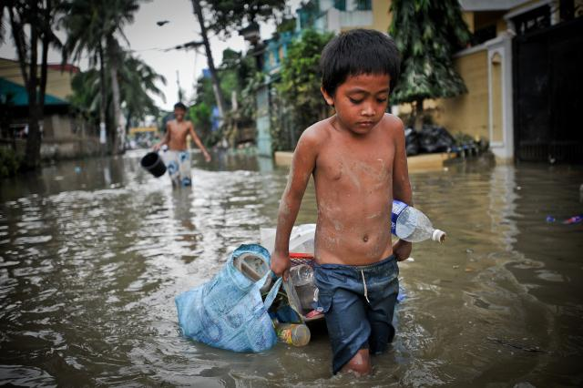 Boy in the Philippines after Typhoon Ketsanaon