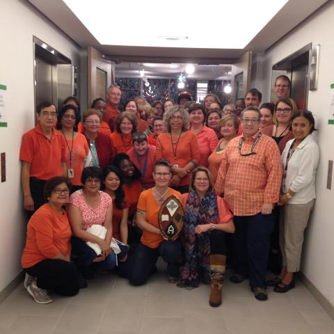 The United Church General Council staff gather in orange shirts, marking Orange Shirt Day which remembers the children who attended Residential Schools.